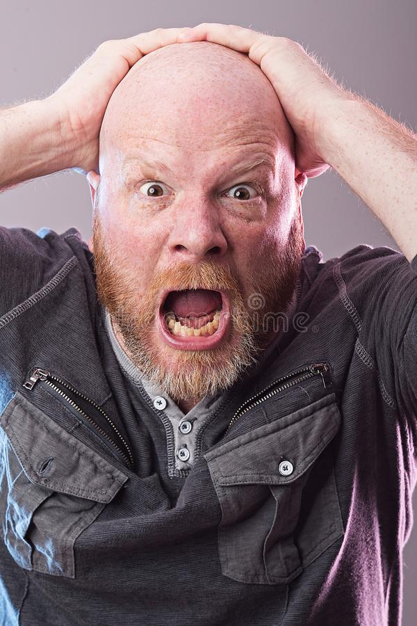 Shocked man with expression of disbelief. Man with hands on his face with expression of shock and disbelief royalty free stock photos