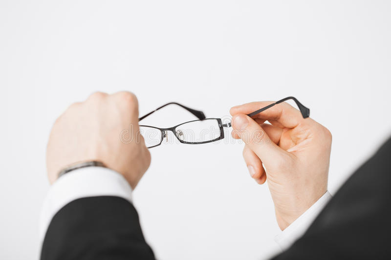 Man Hands Holding Eyeglasses Royalty Free Stock Photos