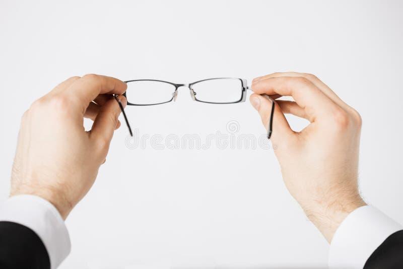 Download Man Hands Holding Eyeglasses Stock Image - Image: 32284585