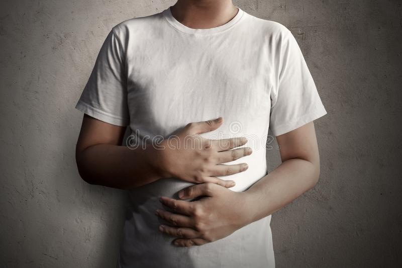 Man hands hold full stomach stock images