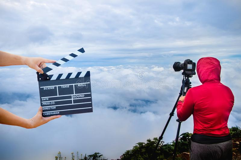 Man hands holding movie clapper.Film director concept.camera show viewfinder image catch motion in interview or broadcast wedding stock images