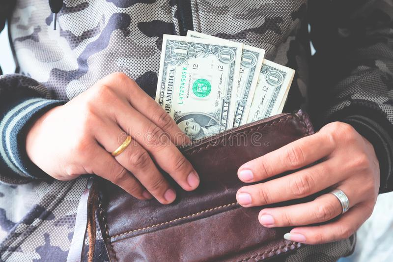 Man hands holding US dollar bills in leather wallet, Freelance. stock photos