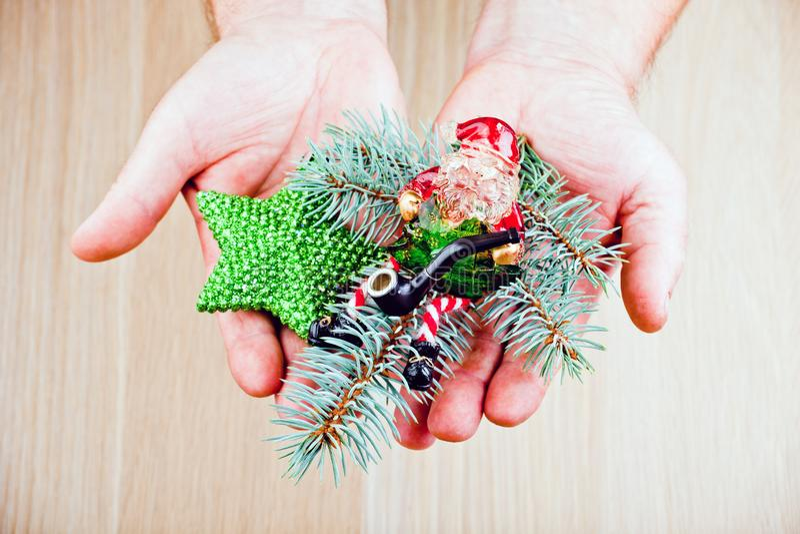 Man hands new year toys Santa Claus fir tree smoking pipe. Studio royalty free stock image