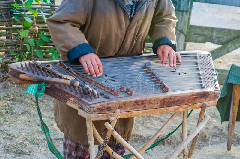 Man hands playing on a harp the Ukrainian national musical instrument royalty free stock photography