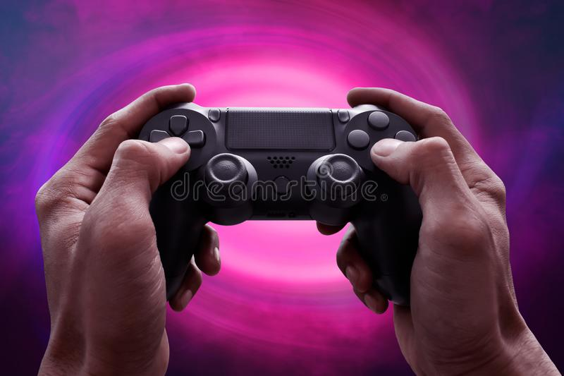 Man hands playing video games. Man hand playing video games royalty free stock image