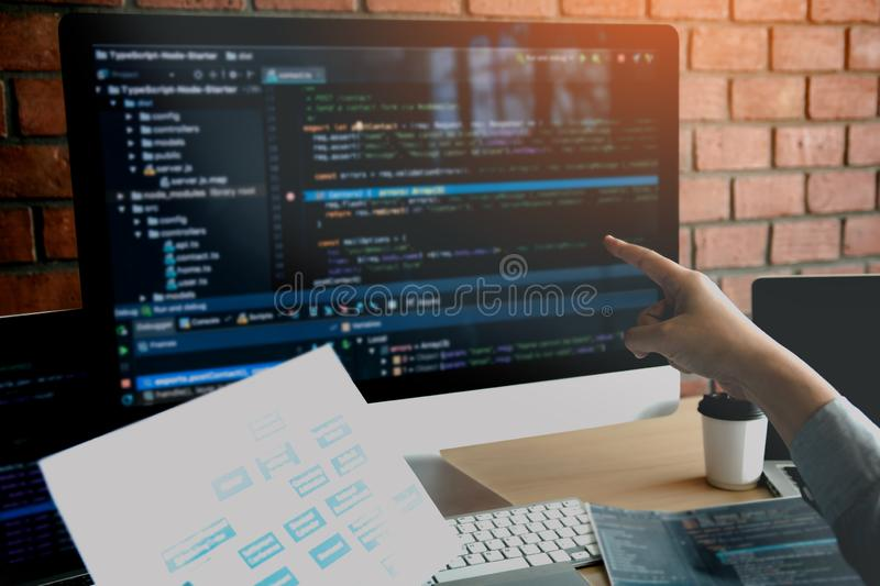 Man hands pointing coding html and programming develop on screen computer stock image