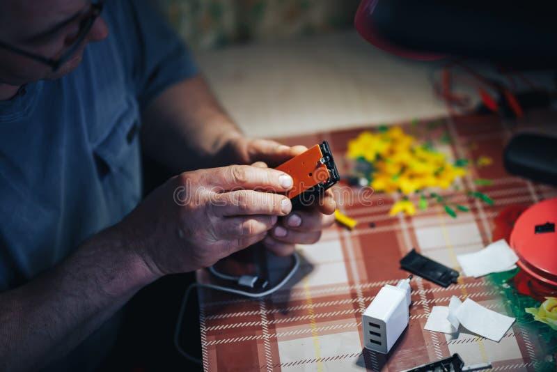man hands repair make broken tv remote royalty free stock photo