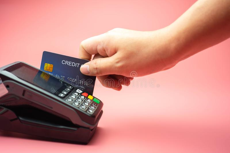 Man Hands swiping Credit card on Credit card machine or Credit card Terminal, Finance concept.  royalty free stock photo