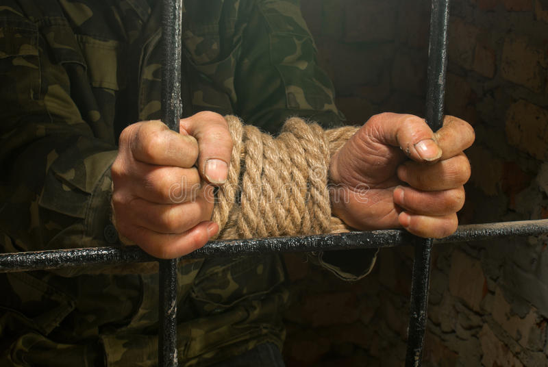 Man with hands tied up with rope