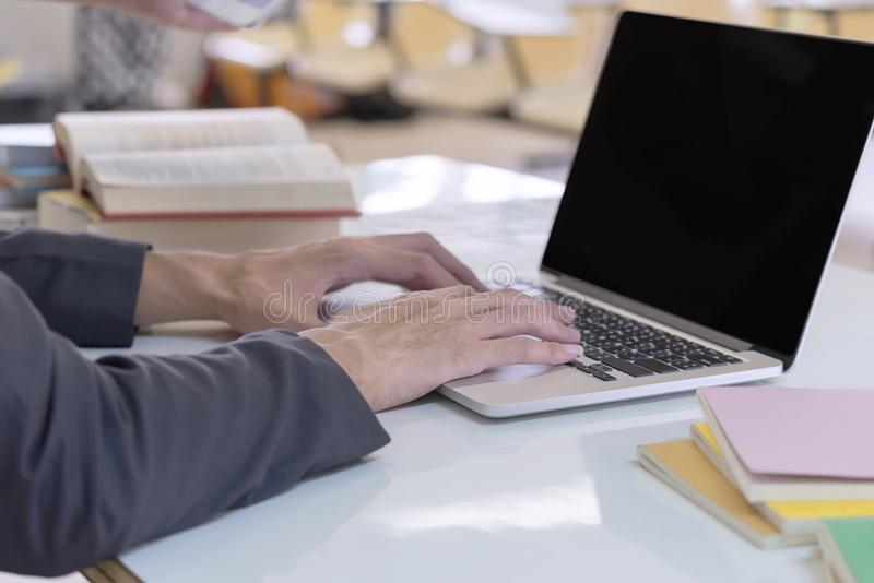 Man hands using computer laptop. Business and Education concept. royalty free stock photos