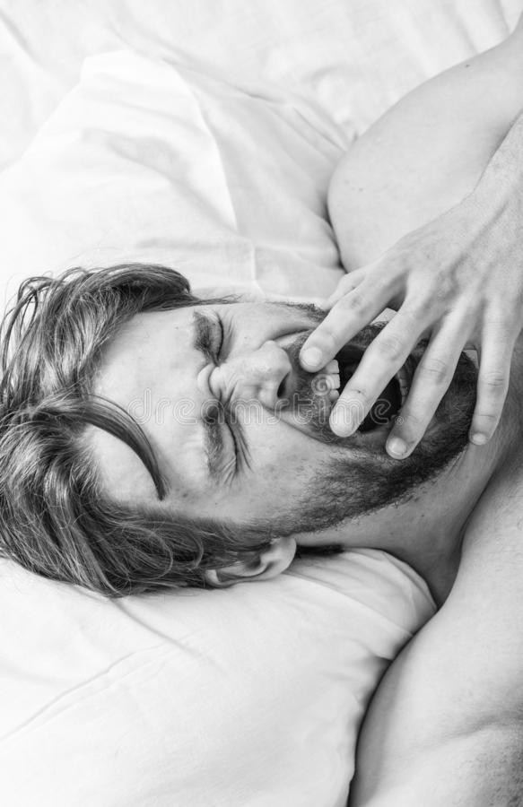 Man handsome guy lay in bed. Get adequate and consistent amount of sleep every night. How much sleep you actually need. Bearded man sleeping face relaxing on stock photo