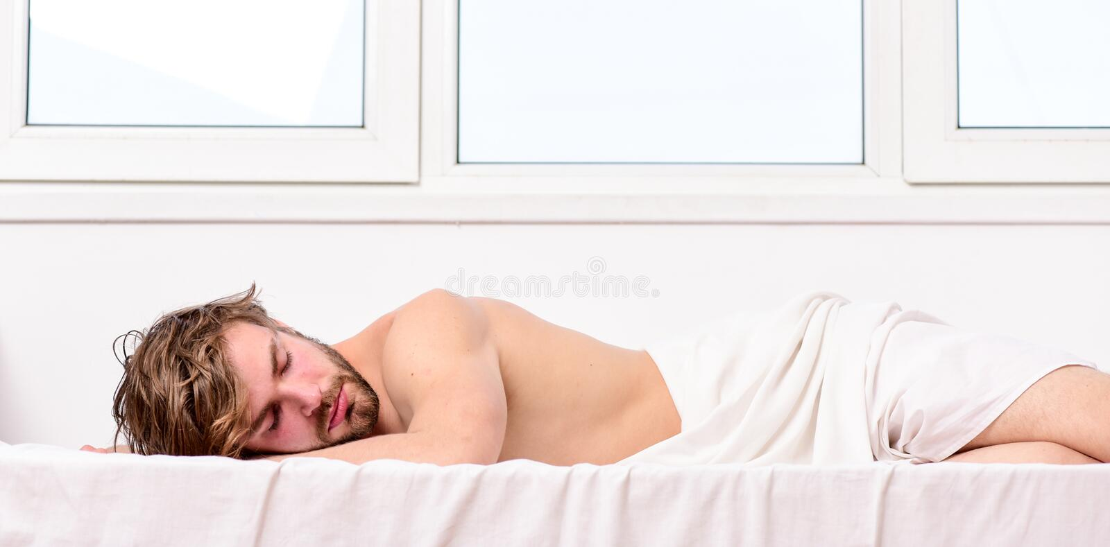 Man handsome guy sleep. Sleep is vital to your physical and mental health. Healthy sleep habits. Man unshaven bearded. Face sleep bed. Time for nap royalty free stock image