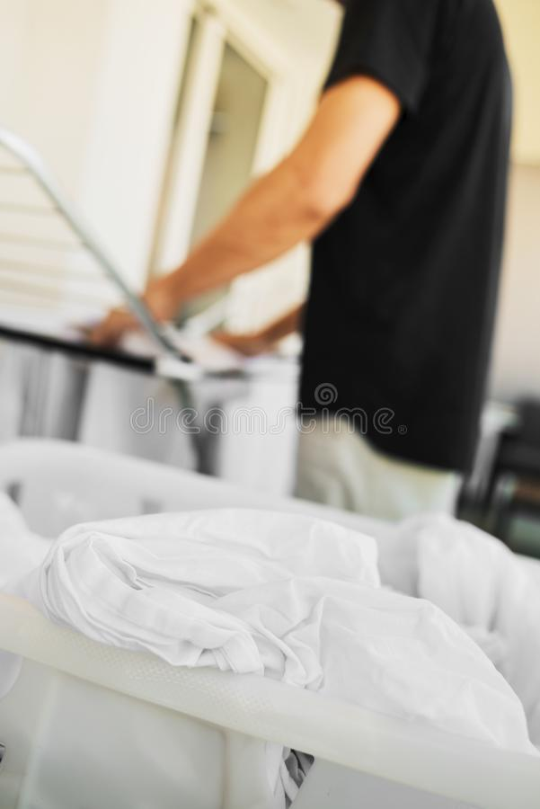 Man hanging clothes on a drying rack stock image