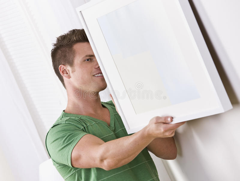 Man Hanging Frame stock photos