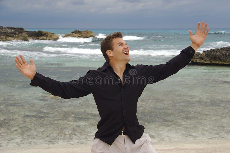 Man happy at beach stock photo