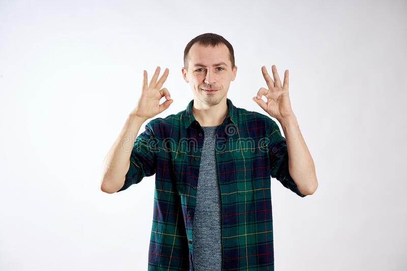 Man is happy, makes gestures with his hands, OK royalty free stock images