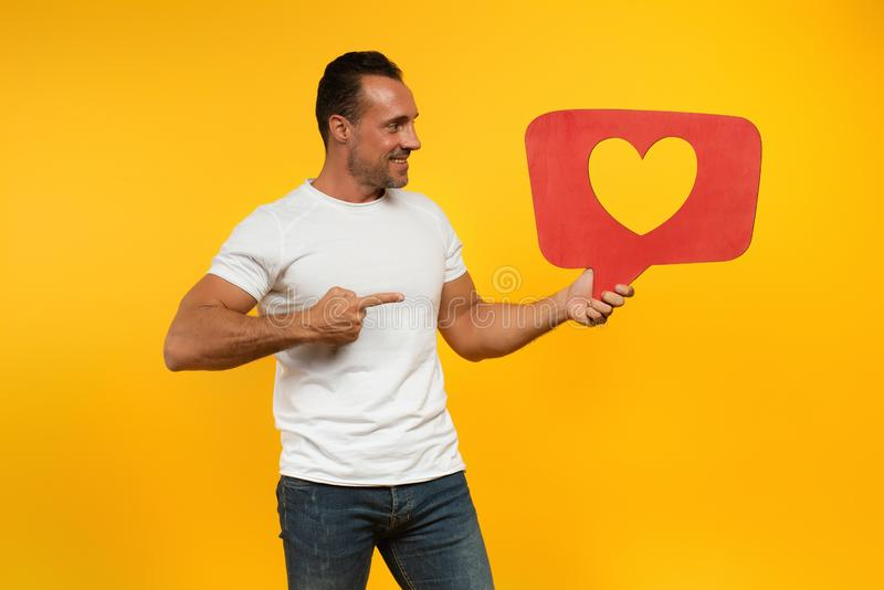 Man is happy because receives hearts on social network. Application royalty free stock images