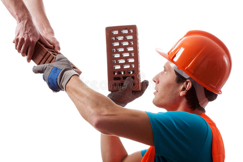 Man in hard hat building a house royalty free stock photos