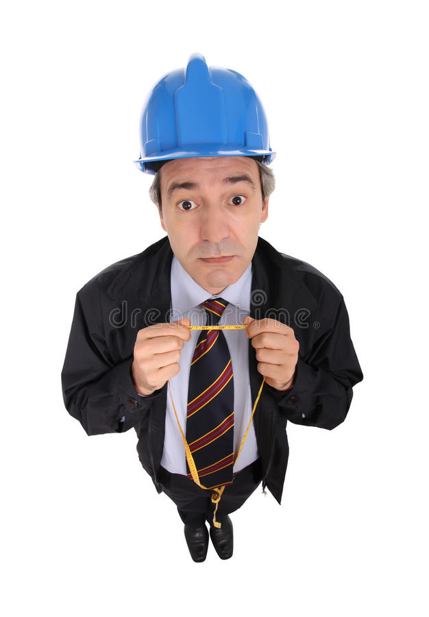 Man with hard hat and tape. Contractor holding a tape measure and wearing a blue hard hat isolated against a white background stock image