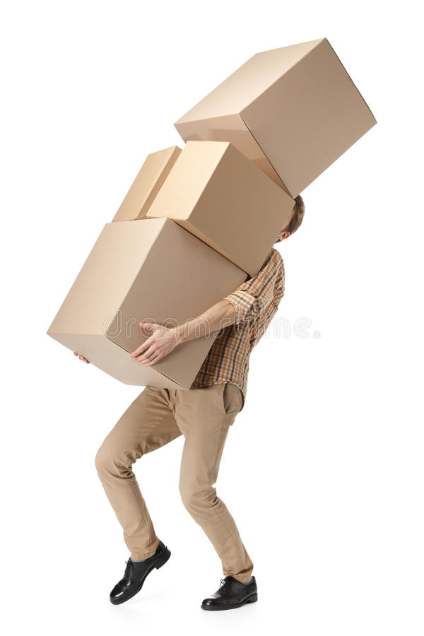 Download Man Hardly Carries The Cardboard Boxes Stock Photo - Image: 25973846