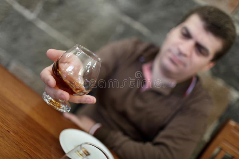 Man has degustation of brandy. In a winery, Armenia royalty free stock photo