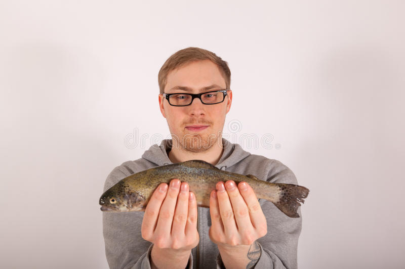 A man has a fish in his hand royalty free stock images