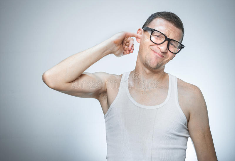 Man has itching in her ear. Funny young man has itching in her ear. Guy waking in morning royalty free stock image