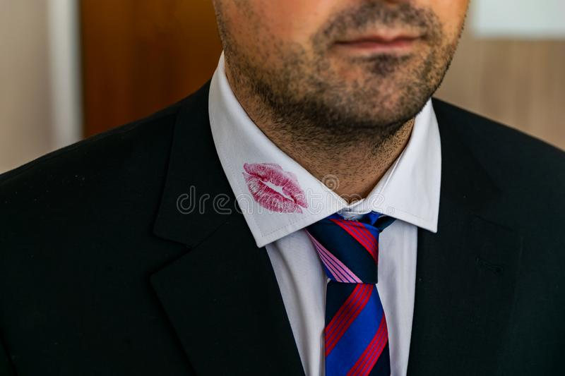 A man has a kiss on the shirt collar royalty free stock image