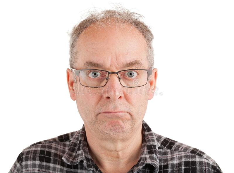 Man is Showing a Poker Face. Man has a poker face royalty free stock photos