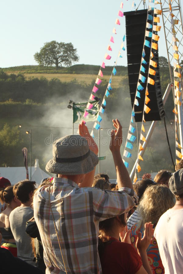 Man in a hat clapping and enjoying the festival. Man in a hat enjoying the music in the sunshine at the first ever Somersault music and outdoor festival at the royalty free stock photo