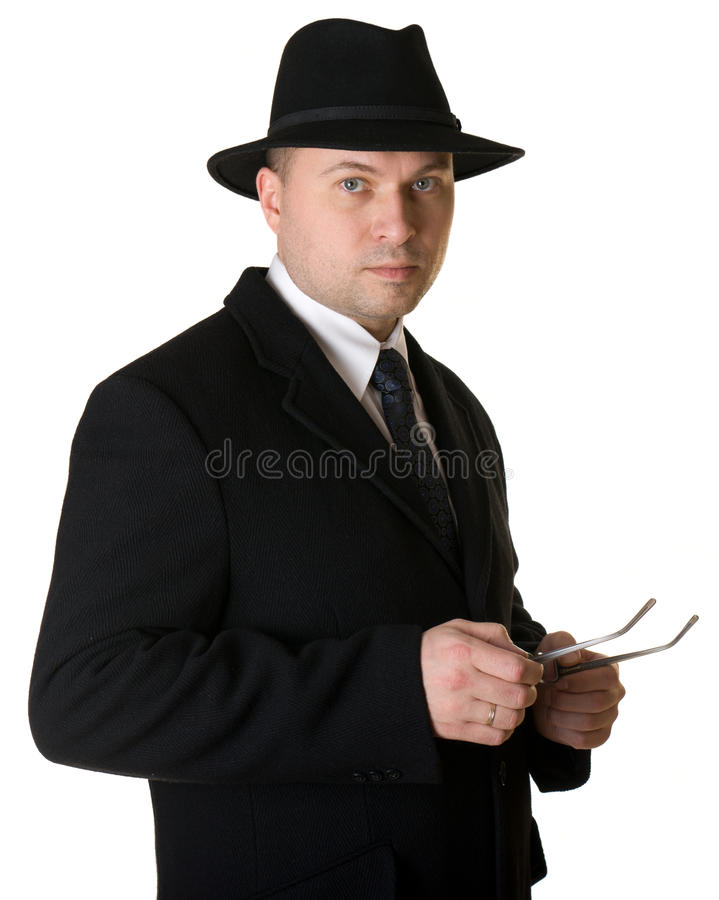 Download A man in a hat and coat stock image. Image of male, hand - 18784395