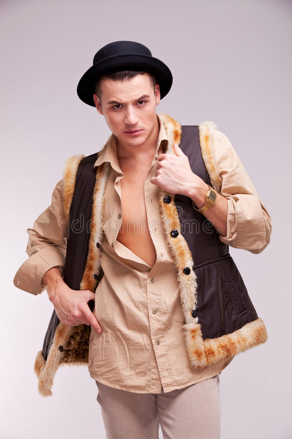 Download Man With Hat And Funny Fur Coat Posing Stock Photo - Image: 23685308