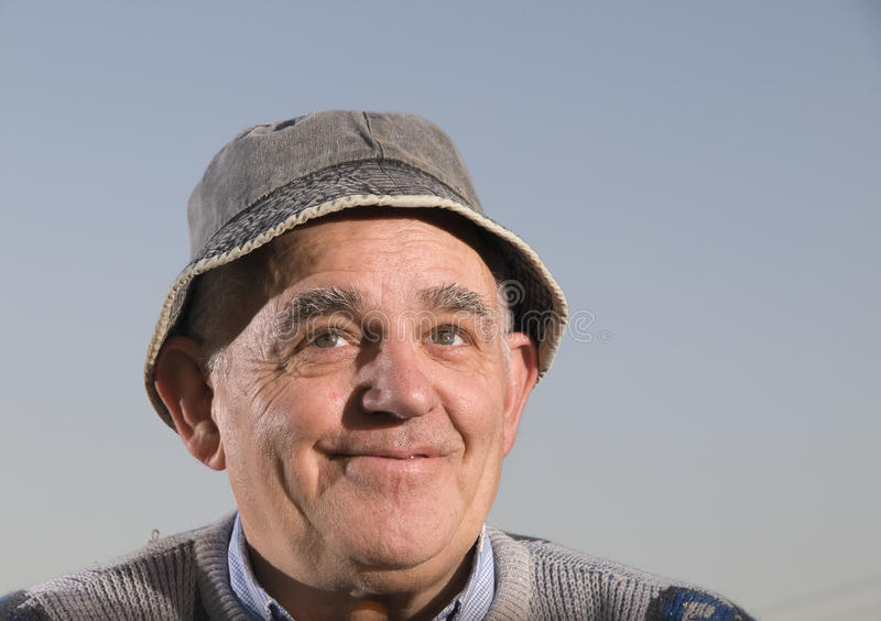 Download Man with hat looking up stock image. Image of satisfied - 24091641