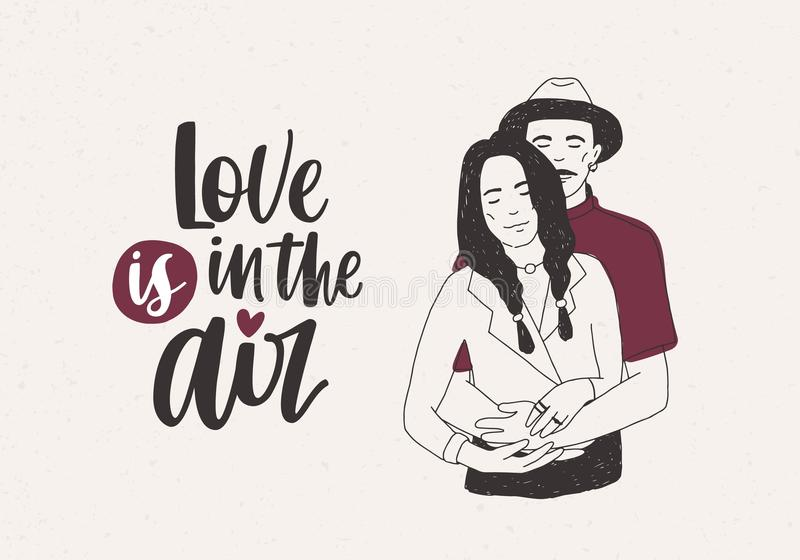 Man in hat standing behind woman with braids and embracing her and Love Is In The Air lettering on light background stock illustration