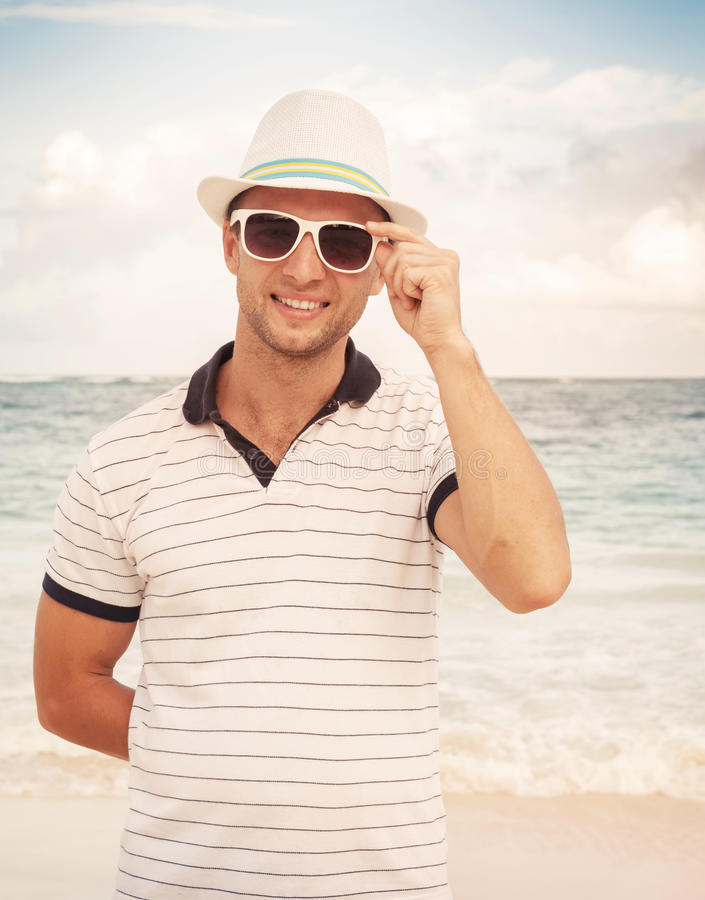 Download Man In Hat And Sunglasses Standing On The Ocean Coast Stock Photo - Image of portrait, shirt: 50438456