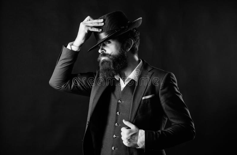 Man with hat. Vintage fashion. Man well groomed bearded gentleman on dark background. Male fashion and menswear. Retro. Fashion hat. Formal suit classic style royalty free stock image