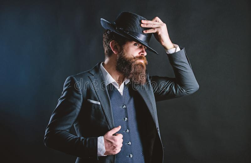 Man with hat. Vintage fashion. Man well groomed bearded gentleman on dark background. Male fashion and menswear. Retro. Fashion hat. Formal suit classic style royalty free stock photo