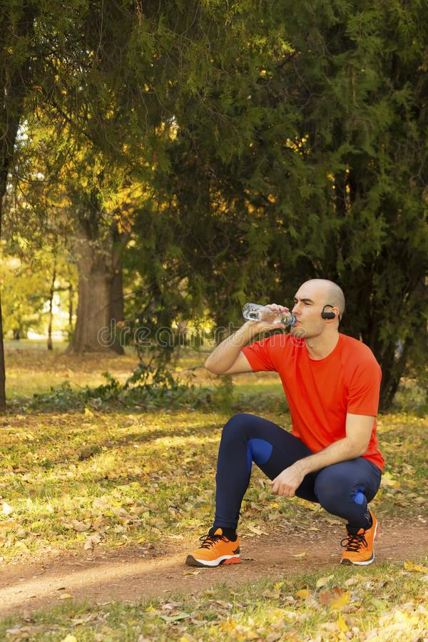 Man have a break after exercise royalty free stock image