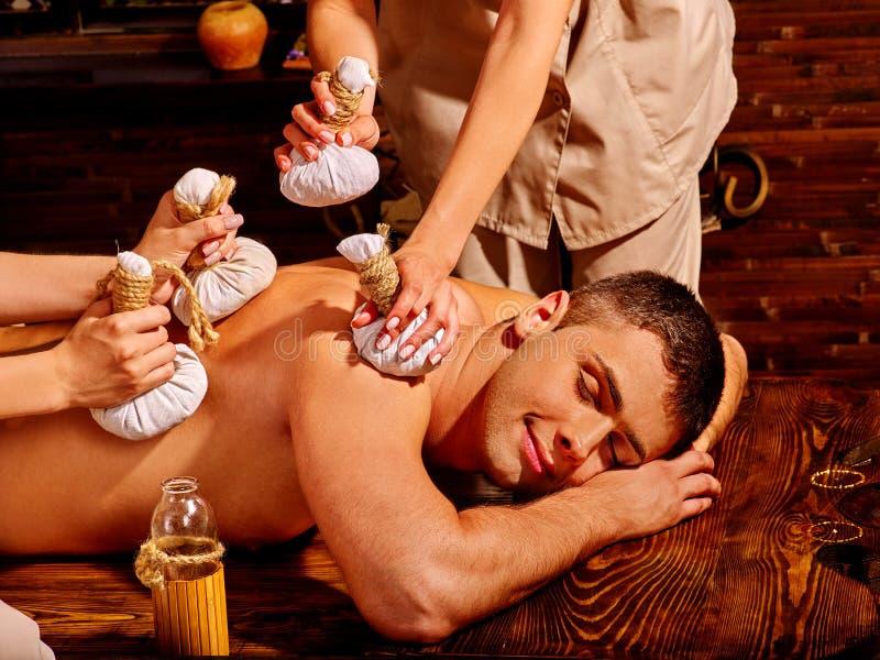 Man having Ayurvedic spa treatment royalty free stock photo