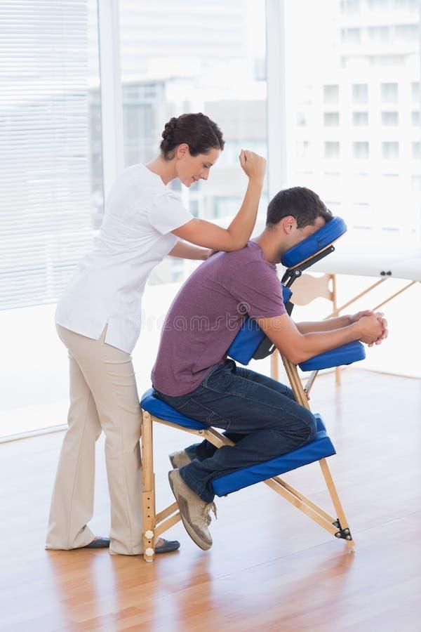 Man having back massage stock images