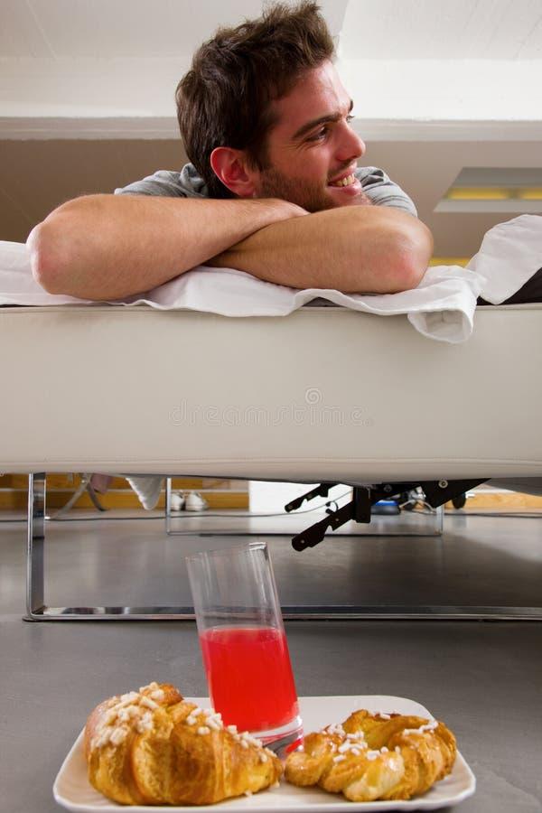 Man having breakfast in bed stock photos