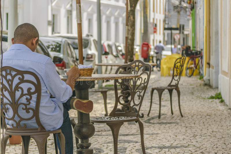 Man Having Coffe at Historic Center of Recife Brazil. RECIFE, BRAZIL, JANUARY - 2016 - Back view of man having a coffe at historical center of Recife, Brazil stock photography