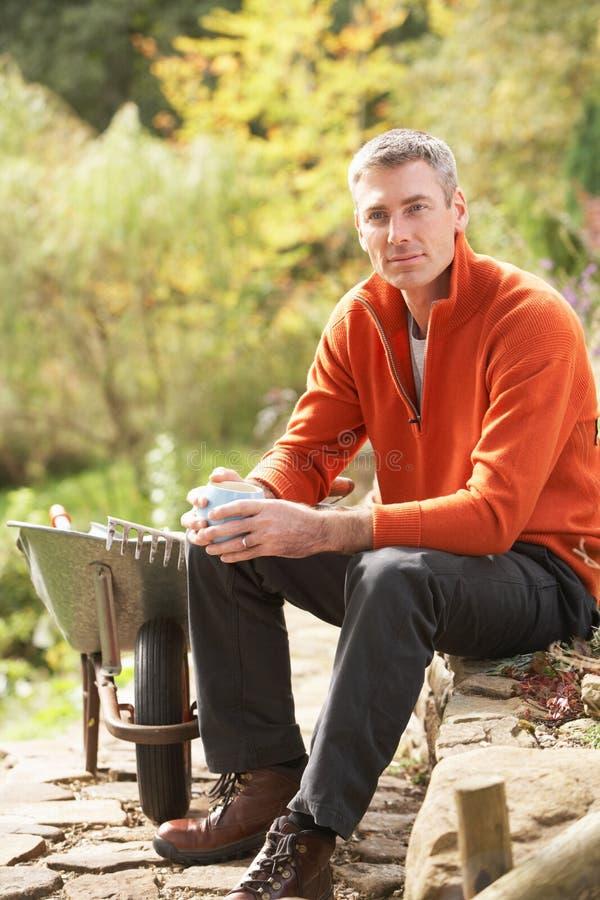Man Having Coffee Break Whilst Working Outdoors stock image