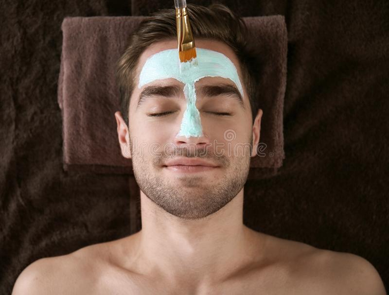 Man having cosmetic mask in salon stock photos