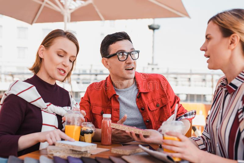 Man having an emotional conversation with his friends royalty free stock image