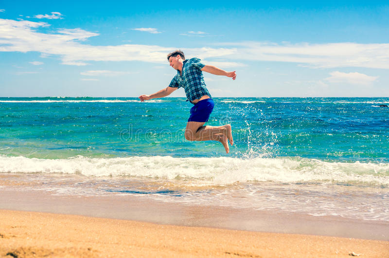 Man having fun at the beach. Travel and Vacation concept. Happy young man having fun outdoors. Joyful man. Summer. Holidays stock photography