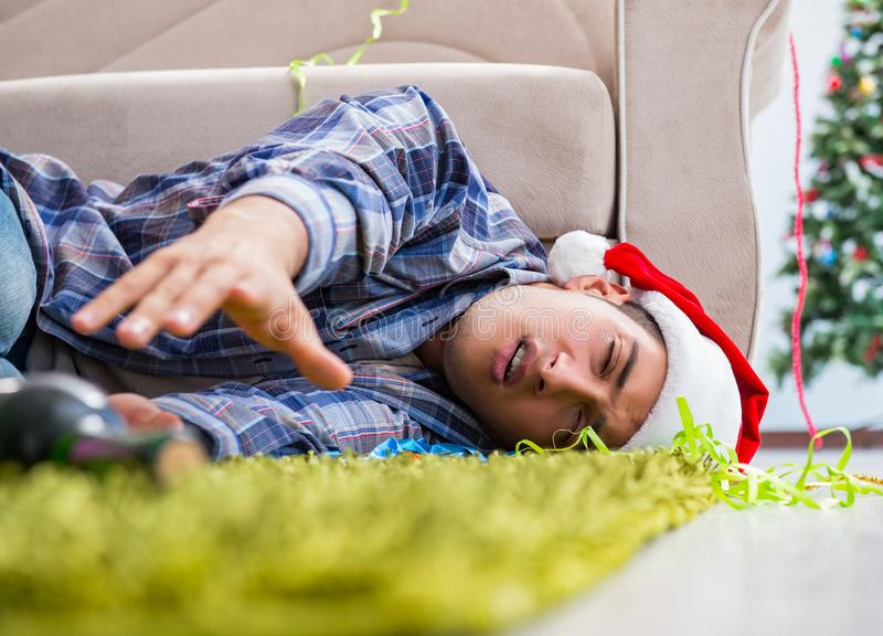 Man having hangover after christmas party royalty free stock photos