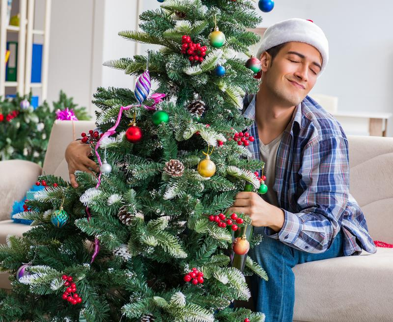 Man having hangover after christmas party. The man having hangover after christmas party stock photos