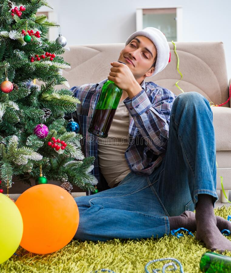 Man having hangover after christmas party royalty free stock photo