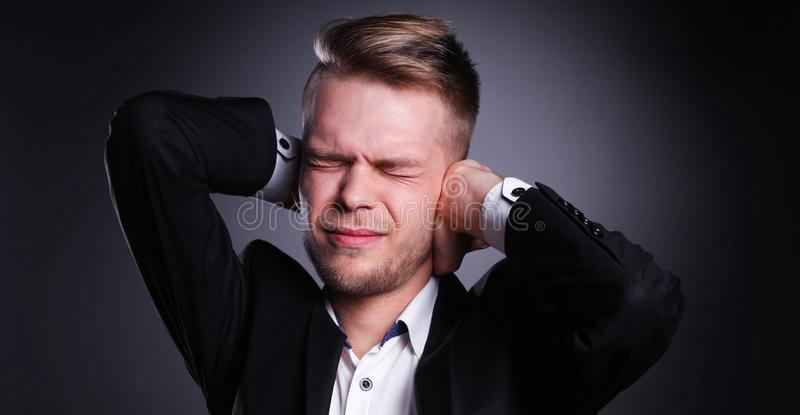 Executive man having head ache isolated on gray background. Man having head ache isolated on gray background stock image